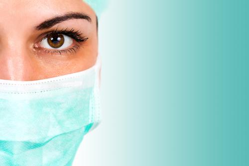 a confident female plastic surgeon